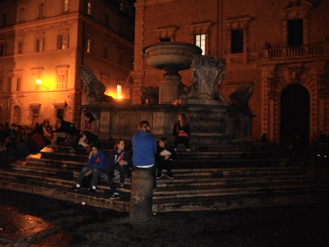 Young people gathering at the fountain in Piazza Santa Maria in Trastevere